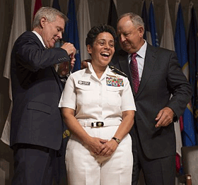 Secretary of the Navy Ray Mabus, left, and Wayne Cowles, husband of Adm. Michelle Howard