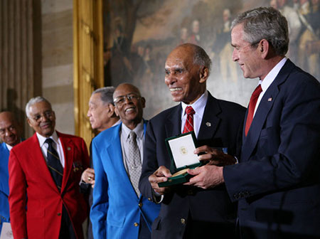 U.S. President George W. Bush presents the Congressional Gold Medal to Dr. Roscoe Brown Jr., during ceremonies honoring the Tuskegee Airmen Thursday, March 29, 2007, at the U.S. Capitol. (White House Photo)
