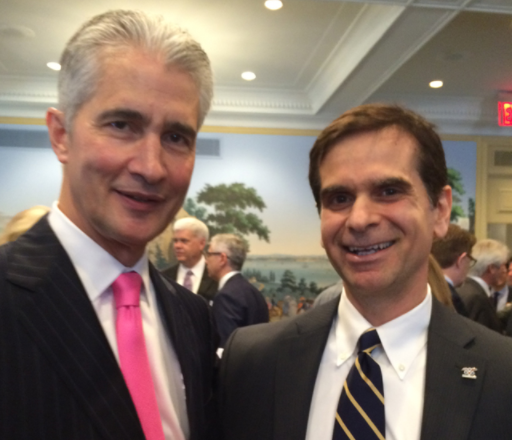 Jeff Smisek, of United Airlines, poses for a picture with Veterans Advantage VP of Marketing, Roy Asfar