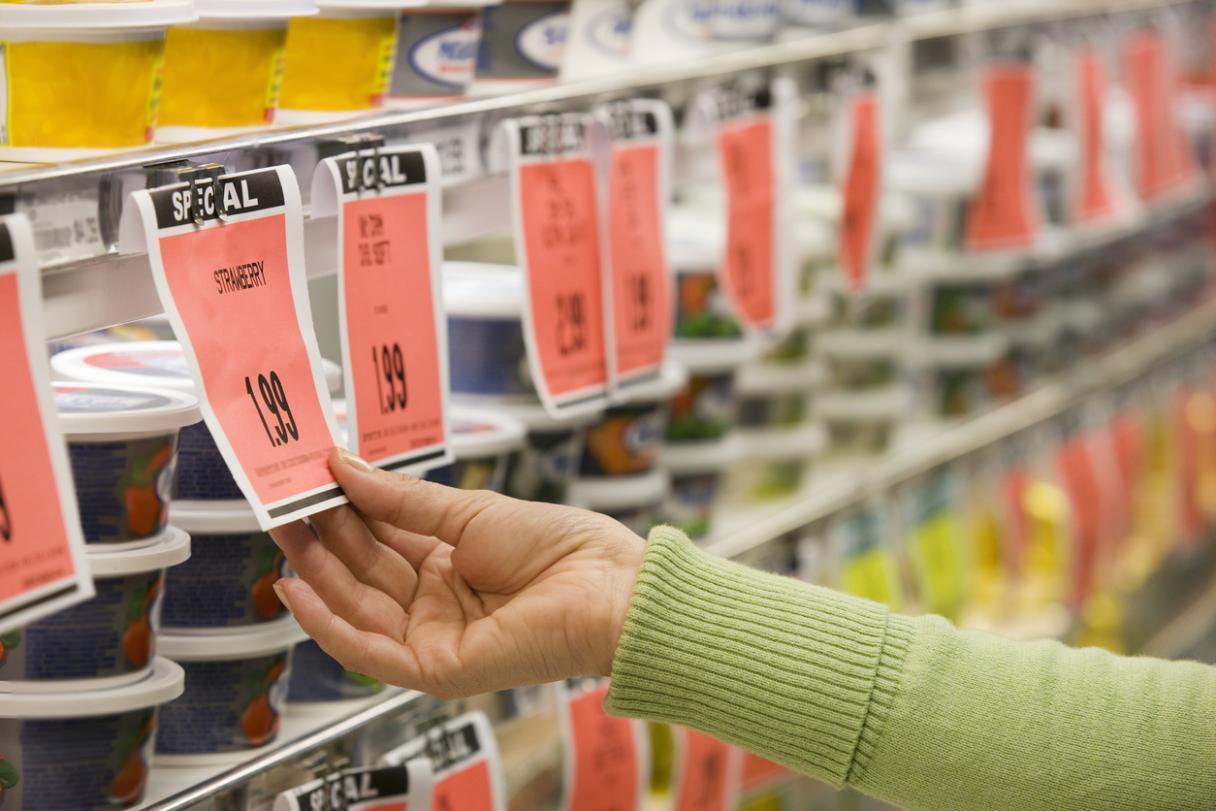 woman looking at sale tag