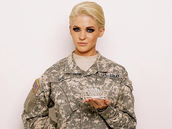 Theresa Vail holding Miss Kansas tiara while in Army uniform