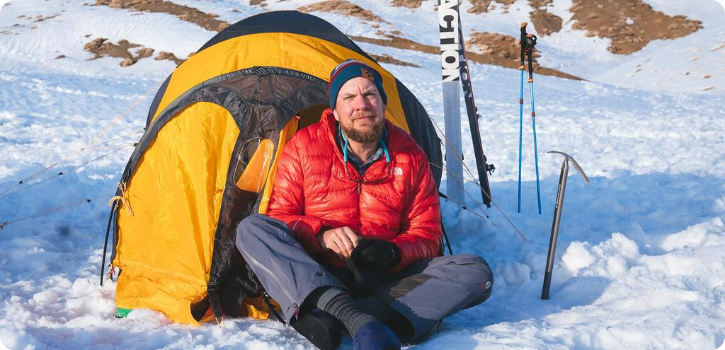 Stacy Bare in front of his tent
