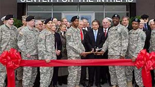 Ribbon Cutting with the Troops. at the center are Arnold Fisher, Richard Santulli (Chairman, Intrepid Fallen Heroes Fund) and Dr. Francis Harvey (Former Secretary of the Army)