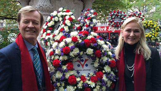 Veterans Advantage Founders Scott and Lin Higgins with the company's memorial wreath.